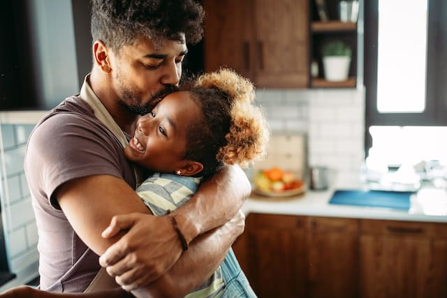 Parent hugging child shows the importance of hugging your child